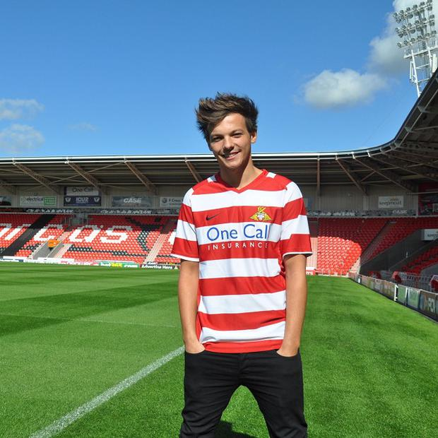 Louis Tomlinson of One Direction is a massive Doncaster Rovers fan