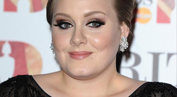 Lawyers for Adele's two-year-old son have accepted a five-figure sum in damages at the High Court over paparazzi photos