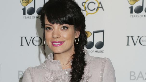 Lily Allen says she tries to block out negative comments about her
