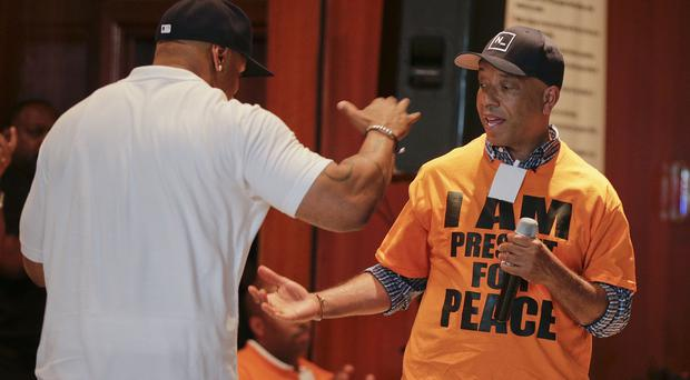 Actor and music artist LL Cool J, left, with Russell Simmons at the juvenile detention section of Rikers Island jail (AP)