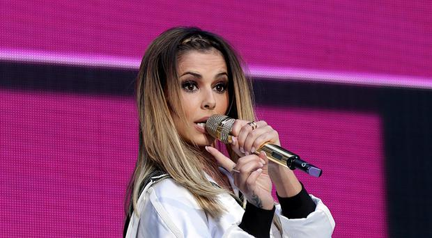 Cheryl Cole's Crazy Stupid Love slipped two places to number four on the singles chart