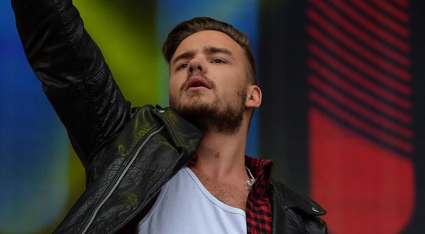 Liam Payne of One Direction is feeling homesick on tour