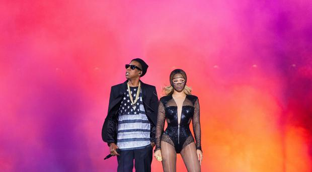 Beyonce and Jay Z perform during their On the Run tour at Stade de France (Rob Hoffman/Invision for Parkwood Entertainment/AP)
