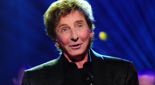Barry Manilow has recorded duets with some late music legends