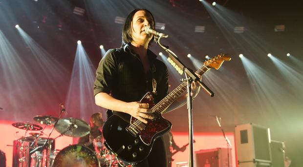 Brian Molko of Placebo on stage at the iTunes Festival