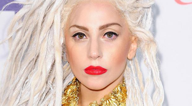 Lady Gaga was cross when her fans fought over her coat