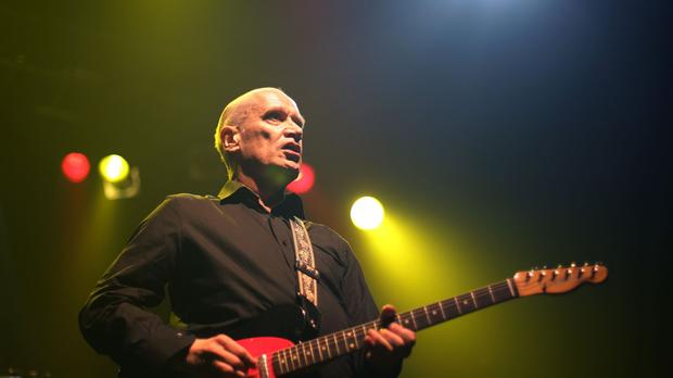 Wilko Johnson performing on stage at Koko in Camden, north London.