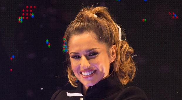 X Factor judge Cheryl Fernandez-Versini watched the remaining acts battle it out
