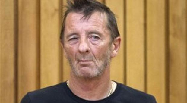 Phil Rudd, drummer for the rock band AC/DC, stands in the dock in the High Court at Tauranga, New Zealand (AP/New Zealand Herald, Alan Gibson)