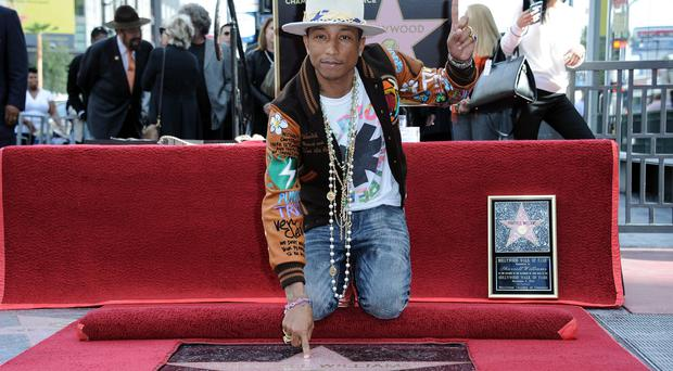 Pharrell Williams with his Hollywood Walk of Fame star (Invision/AP)