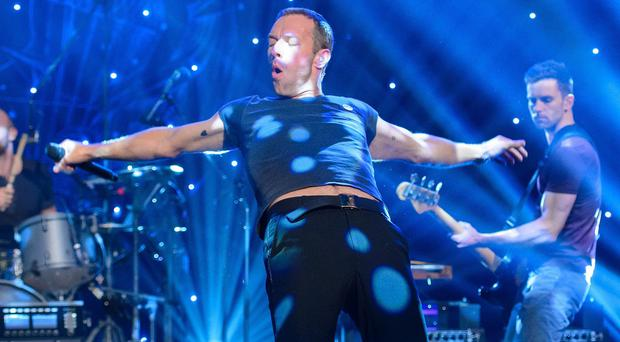 Coldplay have promised some cheerier sounds for their new album