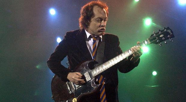 Australian heavymetal band AC/DC's lead guitarist Angus Young will play at Wembley Stadium with his bandmates