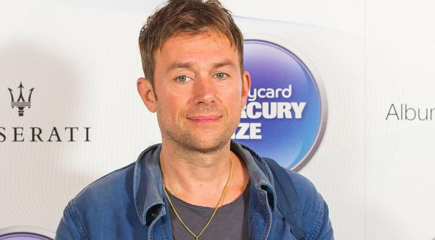 Damon Albarn has postponed a gig at the Sydney Opera House in Australia