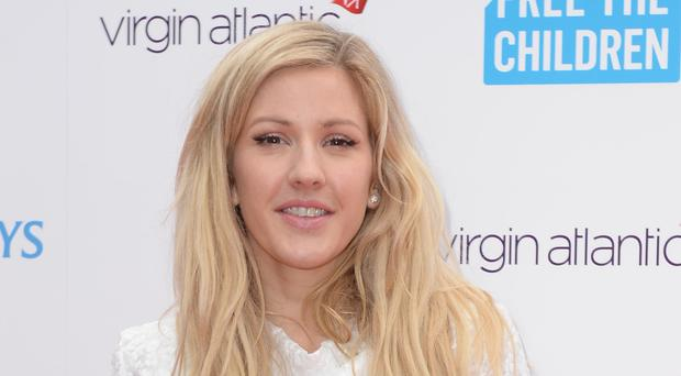 Ellie Goulding will spend Christmas Eve volunteering at a homeless shelter