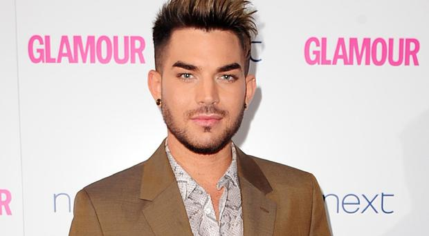 Adam Lambert has been performing with Queen's Brian May and Roger Taylor