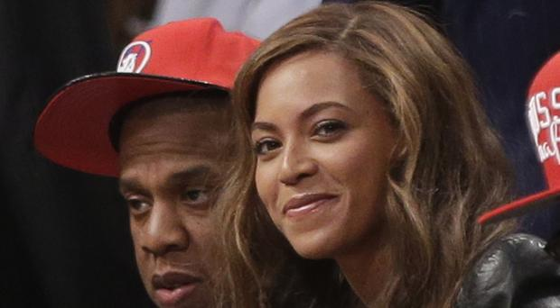 Right-wing politician Mike Huckabee has criticised the Obamas for letting their daughters listen to Beyonce, pictured with husband Jay-Z (AP)