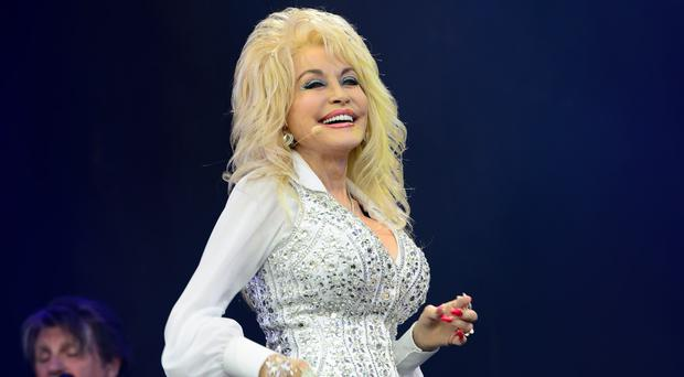Dolly Parton is working on a series of TV movies based on her songs with NBC