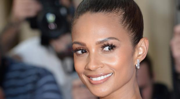 Alesha Dixon is waiting for her boyfriend to go down on one knee and propose properly