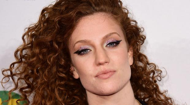 Jess Glynne is number one in the singles chart for a third week with Hold My Hand