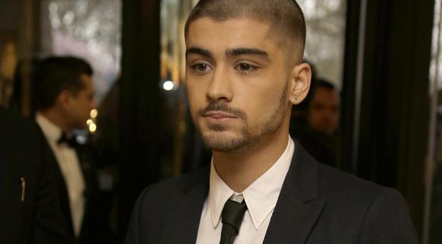 Zayn Malik made his first solo appearance since quitting One Direction at the Asian Awards in central London