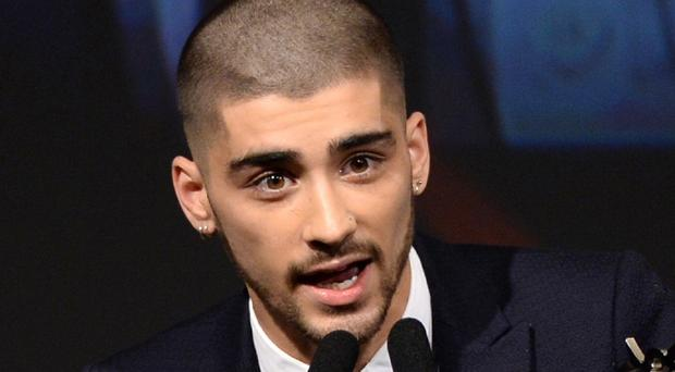Zayn Malik showed off a new shaved hairdo at the Annual Asian Awards