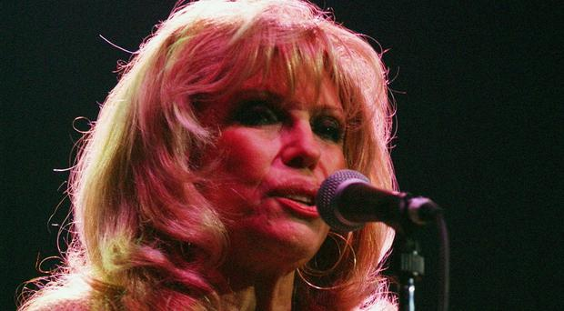 Nancy Sinatra has hit out at performers who use sexy videos to promote their music