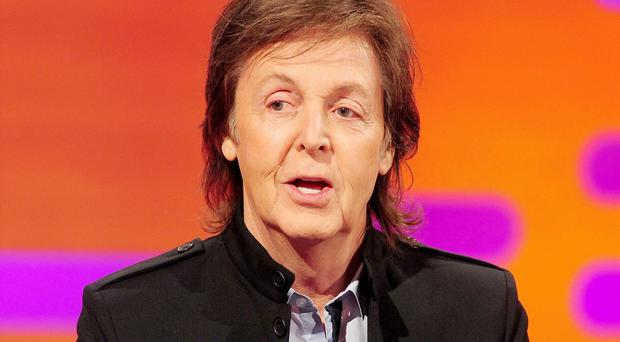 File photo dated 17/10/13 of Sir Paul McCartney who has not had a UK number one single in decades but that has not stopped him topping the only chart that counts - the top 40 musical millionaires.