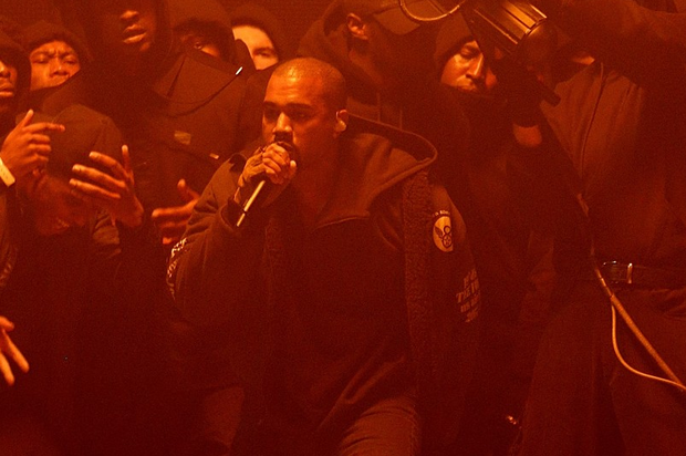 Kanye West performing on stage during the 2015 Brit Awards