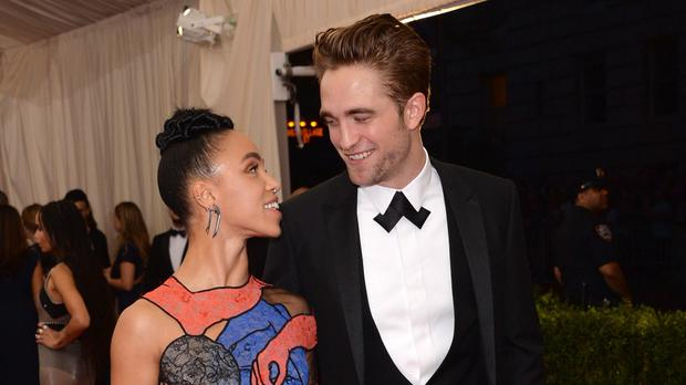 Robert Pattinson and FKA Twigs arrive at the Metropolitan Museum of Art's Costume Institute benefit gala (AP)