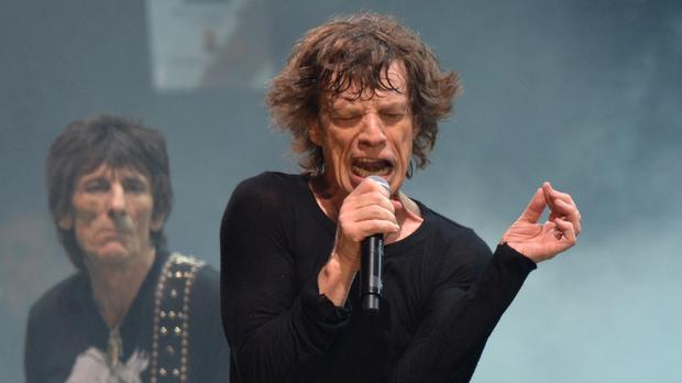 Sir Mick Jagger (right) and Ronnie Wood have helped out with the charity recording