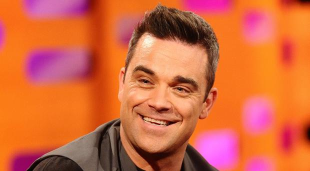 Lawyers for Robbie Williams vowed to strenuously contest a case filed by a former employee