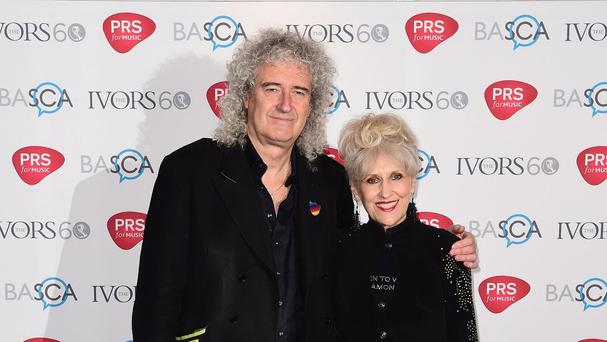 Brian May and Anita Dobson arriving for the 60th annual Ivor Novello Awards