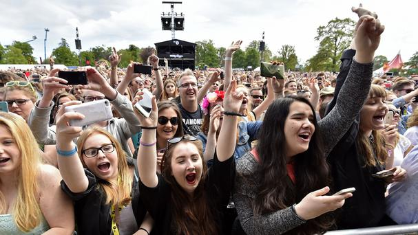 The crowd watch 5 Seconds of Summer performing at the Radio 1 Big Weekend in Earlham Park, Norwich