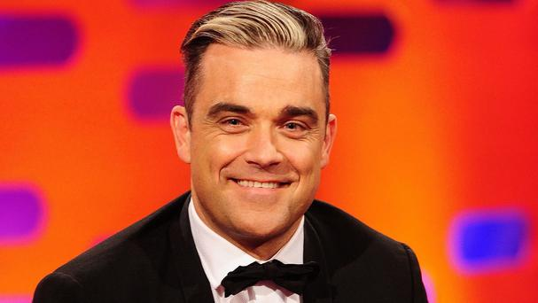 Robbie Williams is putting 150 personal artefacts, including awards, stage costumes and handwritten lyrics, under the hammer