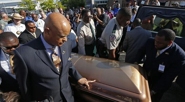 The coffin bearing the body of blues legend B.B. King is wheeled to a waiting hearse (AP)