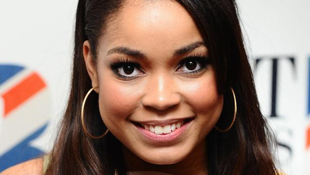 Singer Dionne Bromfield has told how godmother Amy Winehouse shielded her from turmoil