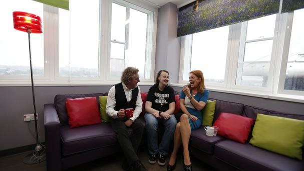 Roger Daltrey (left) and the Duchess of York share a joke with Connor Creasey