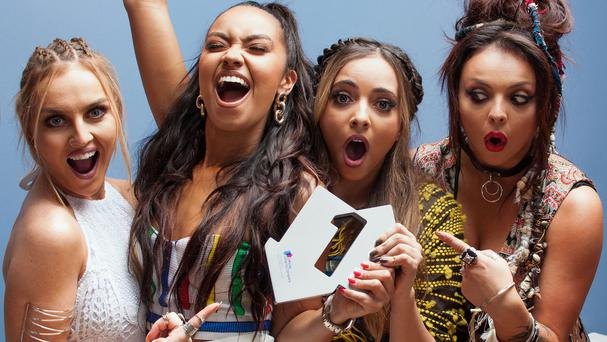 Little Mix members Perrie Edwards, Leigh-Anne Pinnock, Jade Thirlwall and Jesy Nelson celebrate their third number one with Black Magic (OfficialCharts.com/PA)