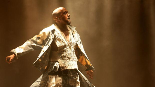 Kanye West, seen here at Glastonbury, walked off stage at the finale of the Pan American Games when his microphone cut out