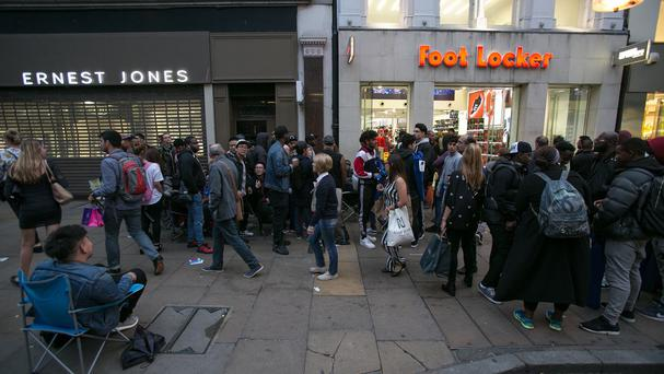 People queuing in front of Foot Locker in Oxford Street for the Kanye West-designed trainers