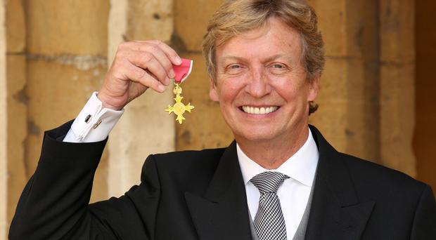 Nigel Lythgoe after receiving an OBE during an Investiture ceremony at Windsor Castle