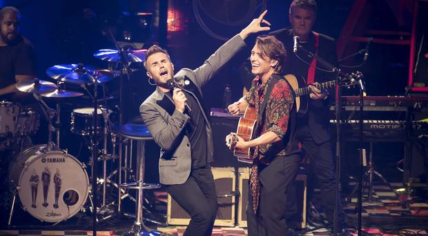 Gary Barlow and Mark Owen on stage at the Roundhouse