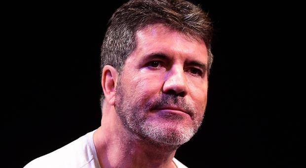 Simon Cowell will be recognised for his contribution to the music and entertainment industry as well as to charitable causes