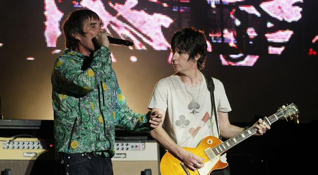 Ian Brown (left) and John Squire of The Stone Roses performing on the Virgin Media Stage at the V Festival in Hylands Park, Chelmsford