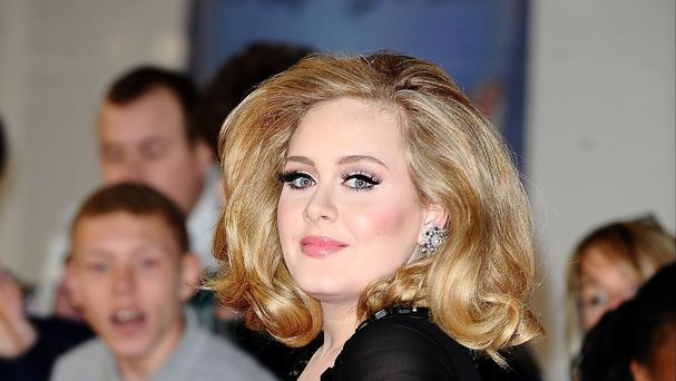 It's a third week at the top of the charts for Adele