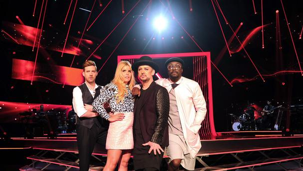 Ricky Wilson, left, has hailed the spirited competition between mentors on The Voice