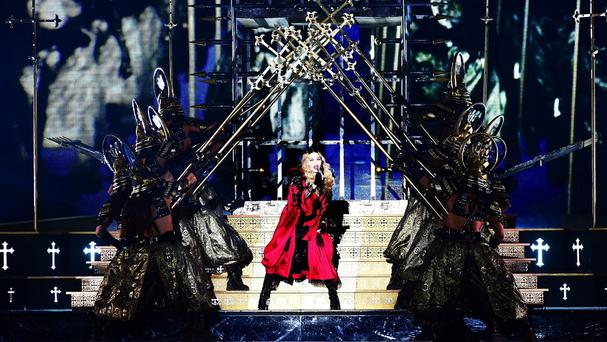 Madonna performing on stage during her Rebel Heart tour
