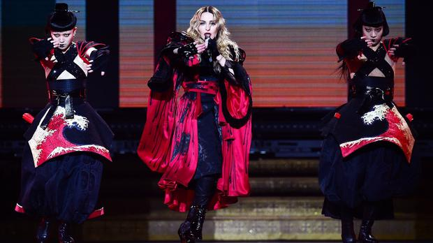 Madonna (centre) led the Glasgow crowd in an encore singalong after power was cut at the end of her concert