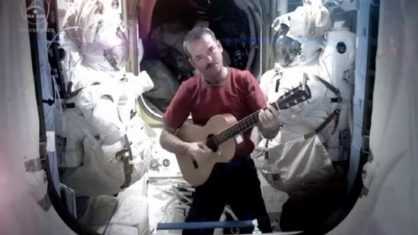 Commander Chris Hadfield said goodbye to life on the International Space Station by making a cover version of David Bowie's Space Oddity (YouTube/PA)