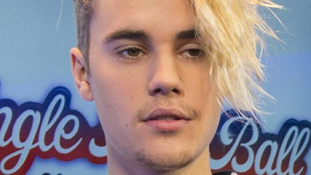 Justin Bieber has broken records with three of the top five in the most recent singles chart